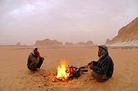 two Beduines at a camp fire in the desert, Egypt, White Desert National Park