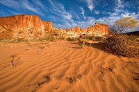 Rainbow Valley _ colourful rock formation with bands of different coloured sandstone, from yellow to orange and rusty brown. After sunset, Australia, ...