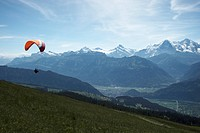 Paraglider at Niederhorn with a view of the mountain range of the Bernese Alps, Canton of Bern, Switzerland, Europe