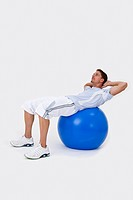 A man using an exercise ball to do sit_ups