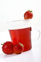 Glass of fruit tea with strawberries