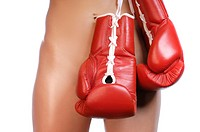 Nude woman with red boxing gloves