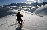 Woman on a snow shoe tour, on the Sennes-plateau, Fanes-Senes-Prags Nature Park, Dolomites, Italy, Europe