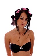 Woman with foam curlers in her hair