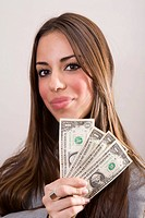 Young woman showing dollars notes