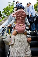 Japanese young mother with backpack baby