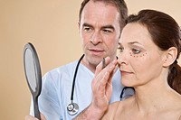 Doctor drawing lines on the face of a patient for a cosmetic surgery