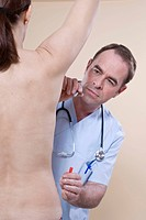 Doctor marking a woman for a breast operation