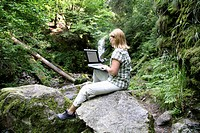 Woman, mid 40, surfing in the Internet outdoors, Ravennaschlucht Gorge, Hinterzarten, Black Forest, Germany, Europe