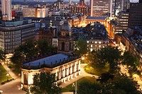 St  Philips Cathedral in the centre of Birmingham, UK  Office buildings in the city  Aerial at night