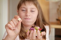 Girl with sweets and diaet _ tablet