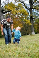 little child in park with father