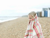young Girl huddled in blanket