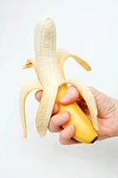Peeled banana in hand