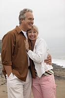 Couple embracing on beach portrait