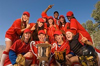 Women's softball team with trophy portrait