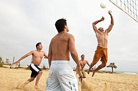 Men Playing Volleyball on beach