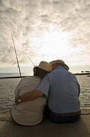 Senior couple fishing at ocean