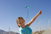 Girl 7_9 with kite on wind farm portrait