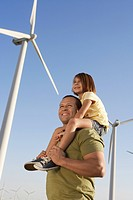 Father and daughter 5_6 on wind farm side view