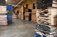 Stacks of wood in warehouse