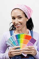 Woman holding paint colour samples portrait