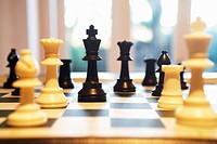 Chess pieces standing on chess board (thumbnail)