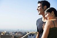 Young couple enjoying view portrait (thumbnail)