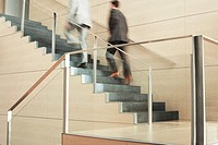 Businessmen Climbing Stairs