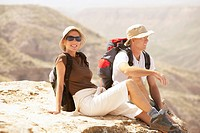 Hiking couple sitting on mountain
