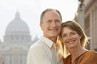 Middle_aged couple hugging in Rome Italy front view portrait