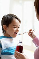 Mother Giving Son Cough Syrup (thumbnail)