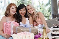 Friends sitting Together with gifts at Bridal Shower