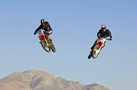 Two motocross Racers in mid_air