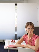 Businesswoman at desk half length (thumbnail)