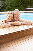 Middle_aged couple standing in pool at edge portrait