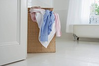 Overflowing laundry basket in bathroom