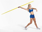Female athlete preparing to throw javelin side view