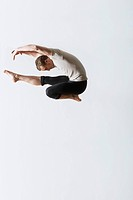 Ballet dancer leaping in mid_air