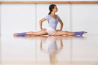Dancer Stretching on floor (thumbnail)