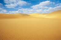 Desert and sand dunes under blue sky