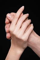 Young couple holding hands arms raised together close-up of hands (thumbnail)