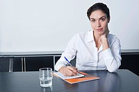 Businesswoman sitting at desk in office portrait