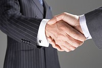 Businessmen Shaking Hands close_up on hands