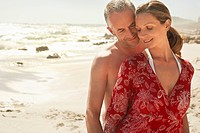 Romantic couple on beach smiling