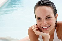 Young woman relaxing in swimming pool portrait close_up