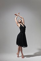 young woman doing ballet, studio