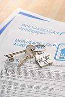 Keys to a New Home and mortgage papers on table
