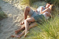 Couple lying and embracing in Secluded Spot on Beach high angle view