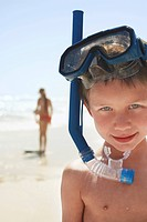 Boy 5-6 in snorkel on beach close-up portrait (thumbnail)